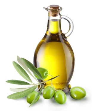 Branch with olives and a bottle of olive oil isolated on white