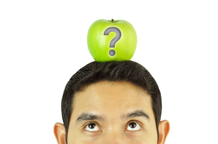 Young man with apple on his head and question mark