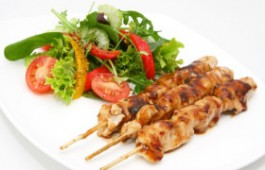 Delicious chicken satay skewers with fresh green salad.